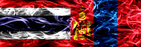 Thailand vs Mongolia, Mongolian smoke flags placed side by side. Thick abstract colored silky smoke flags Stockfoto