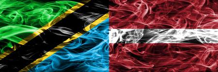 Tanzania vs Latvia, Latvian smoke flags placed side by side. Thick colored silky smoke flags of Tanzanian and Latvia, Latvian 版權商用圖片