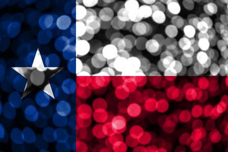 Texas abstract blurry bokeh flag. Christmas, New Year and National day concept flag. United States of America.