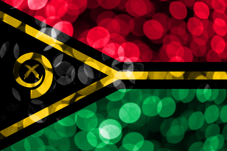 Vanuatu abstract blurry bokeh flag. Christmas, New Year and National day concept flag.