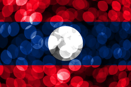Laos abstract blurry bokeh flag. Christmas, New Year and National day concept flag.