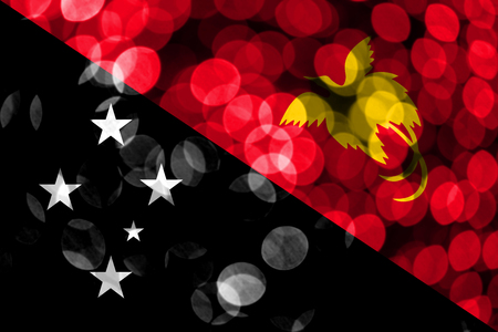 Papua New Guinea abstract blurry bokeh flag. Christmas, New Year and National day concept flag.