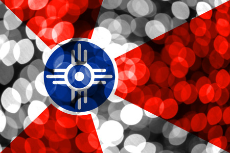Wichita, Kansas abstract blurry bokeh flag. Christmas, New Year and National day concept flag. United States of America. Stock Photo