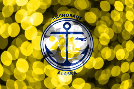 Anchorage, Alaska abstract blurry bokeh flag. Christmas, New Year and National day concept flag. United States of America. 스톡 콘텐츠