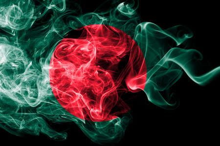 National flag of Bangladesh made from colored smoke isolated on black background. Abstract silky wave background. Archivio Fotografico
