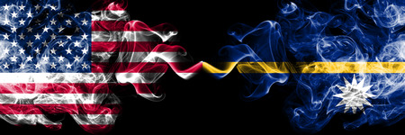 United States of America vs Nauru smoky mystic flags placed side by side. Thick colored silky smoke flags of America and Nauru. 版權商用圖片