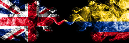 United Kingdom vs Colombia, Colombian smoky mystic flags placed side by side. Thick colored silky smoke flags of Great Britain and Colombia, Colombian.