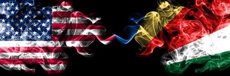United States of America vs Seychelles, Seychelloise smoky mystic flags placed side by side. Thick colored silky smoke flags of America and Seychelles, Seychelloise. Reklamní fotografie