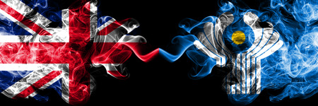 United Kingdom vs Commonwealth smoky mystic flags placed side by side. Thick colored silky smoke flags of Great Britain and Commonwealth.