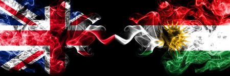 United Kingdom vs Kurdistan, Kurdish smoky mystic flags placed side by side. Thick colored silky smoke flags of Great Britain and Kurdistan, Kurdish.
