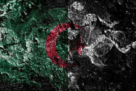 Algeria smoky mystical flag on the old dirty wall background