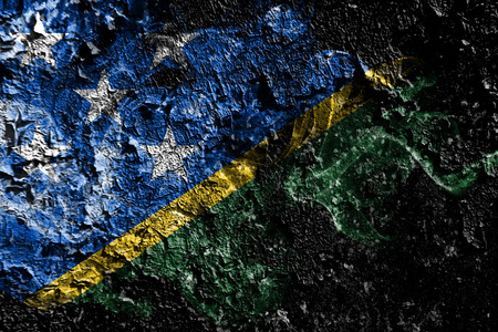 Solomon Islands smoky mystical flag on the old dirty wall background Stock Photo