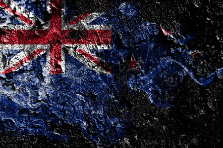 New Zealand smoky mystical flag on the old dirty wall background 免版税图像