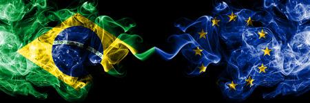 Brazil vs European Union, EU smoke flags placed side by side. Thick colored silky smoke flags of Brazilian and European Union, EU