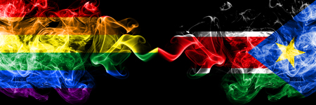Gay vs South Sudan smoke flags placed side by side. Thick colored silky smoke flags of Pride and South Sudan