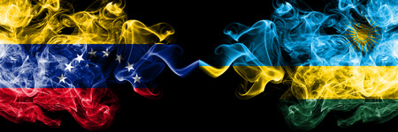 Venezuela vs Rwanda, Rwandan smoky mystic flags placed side by side. Thick colored silky smoke flags of Venezuela and Rwanda, Rwandan.