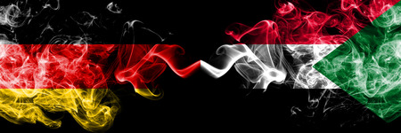 Germany vs Sudan, Sudanese smoky mystic flags placed side by side. Thick colored silky smoke flags of Deutschland and Sudan, Sudanese.