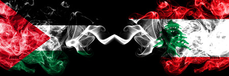 Palestine vs Lebanon, Lebanese smoky mystic flags placed side by side. Thick colored silky smokes flag of Palestinians and Lebanon, Lebanese. Stock Photo