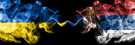 Ukraine, Serbia competition thick colorful smoky flags. European football qualifications games Stock Photo