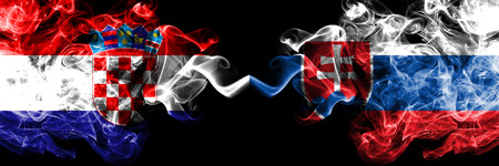Croatia, Croatian, Slovakia, Slovakian competition thick colorful smoky flags. European football qualifications games Stock Photo