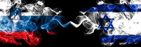 Slovenia, Slovenian, Israel, Israeli competition thick colorful smoky flags. European football qualifications games Stock Photo