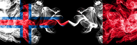 Faroe Islands, Malta, Maltese competition thick colorful smoky flags. European football qualifications games Stock Photo