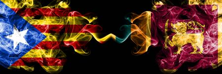 Catalonia vs Sri Lanka, Sri Lankan smoke flags placed side by side. Thick colored silky smoke flags of Catalonia and Sri Lanka, Sri Lankan Foto de archivo