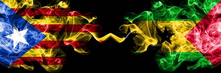 Catalonia vs Sao Tome and Principe smoke flags placed side by side. Thick colored silky smoke flags of Catalonia and Sao Tome and Principe