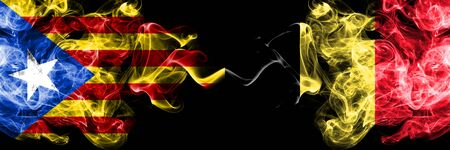 Catalonia vs Belgium, Belgian smoke flags placed side by side. Thick colored silky smoke flags of Catalonia and Belgium, Belgian