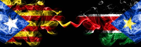 Catalonia vs South Sudan smoke flags placed side by side. Thick colored silky smoke flags of Catalonia and South Sudan