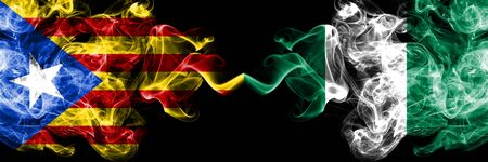 Catalonia vs Nigeria, Nigerian smoke flags placed side by side. Thick colored silky smoke flags of Catalonia and Nigeria, Nigerian Stock Photo - 124875182