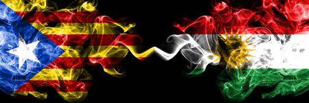 Catalonia vs Kurdistan, Kurdish smoke flags placed side by side. Thick colored silky smoke flags of Catalonia and Kurdistan, Kurdish