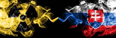 Slovakia, Slovakian vs nuclear smoky mystic flags placed side by side. Thick colored silky smokes combination of Slovakia, Slovakian flag and radioactive sign.