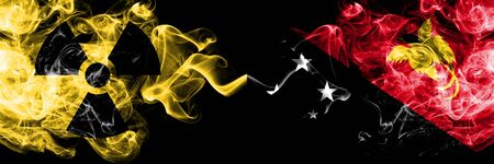 Papua New Guinea vs nuclear smoky mystic flags placed side by side. Thick colored silky smokes combination of Papua New Guinea flag and radioactive sign.
