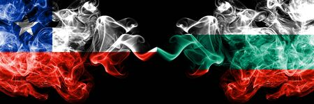 Japan vs Bulgaria, Bulgarian smoky mystic flags placed side by side. Thick colored silky smokes combination of Bulgaria, Bulgarian and Japanese flag
