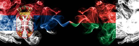 Serbia vs Madagascar, Madagascan smoky mystic flags placed side by side. Thick colored silky smokes combination of Serbian and Madagascar, Madagascan flag Stok Fotoğraf