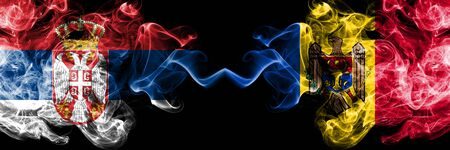 Serbia vs Moldova, Moldovan smoky mystic flags placed side by side. Thick colored silky smokes combination of Serbian and Moldova, Moldovan flag Standard-Bild