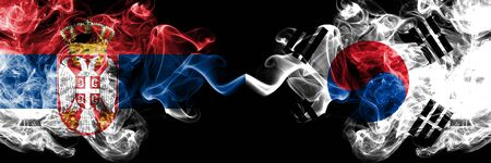 Serbia vs South Korea, Korean smoky mystic flags placed side by side. Thick colored silky smokes combination of Serbian and South Korea, Korean flag Standard-Bild