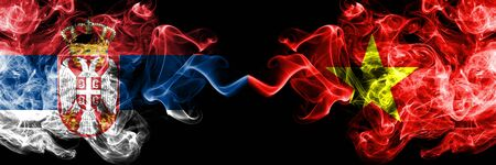 Serbia vs Vietnam, Vietnamese smoky mystic flags placed side by side. Thick colored silky smokes combination of Serbian and Vietnam, Vietnamese flag Stock Photo