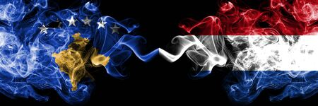 Kosovo vs Netherlands, Dutch smoky mystic flags placed side by side. Thick colored silky smokes combination of Kosovo and Netherlands, Dutch flag Stock Photo