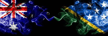 Australia vs Solomon Islands smoky mystic flags placed side by side. Thick colored silky smokes combination of national flags of Australia and Solomon Islands Stock Photo