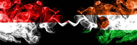 Indonesia vs Niger, Nigerian smoky mystic flags placed side by side. Thick colored silky smoke flags of Indonesia and Niger, Nigerian Stock Photo