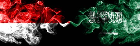 Indonesia vs Saudi Arabia, Arabian smoky mystic flags placed side by side. Thick colored silky smoke flags of Indonesia and Saudi Arabia, Arabian Stock Photo
