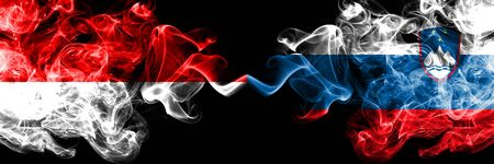 Indonesia vs Slovenia, Slovenian smoky mystic flags placed side by side. Thick colored silky smoke flags of Indonesia and Slovenia, Slovenian