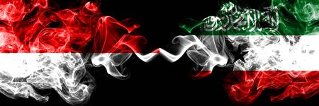 Indonesia vs Somaliland smoky mystic flags placed side by side. Thick colored silky smoke flags of Indonesia and Somaliland Stock Photo