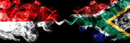 Indonesia vs South Africa, African smoky mystic flags placed side by side. Thick colored silky smoke flags of Indonesia and South Africa, African