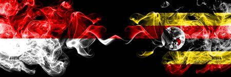 Indonesia vs Uganda, Ugandan smoky mystic flags placed side by side. Thick colored silky smoke flags of Indonesia and Uganda, Ugandan Stock Photo