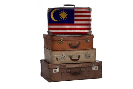 Malaysia, Malaysian travel concept. Group of vintage suitcases isolated on white background