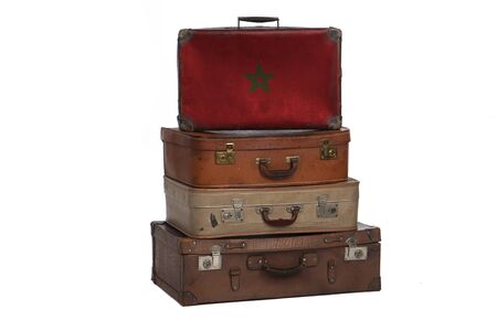 Morocco, Moroccan travel concept. Group of vintage suitcases isolated on white background