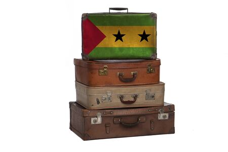 Sao Tome and Principe travel concept. Group of vintage suitcases isolated on white background Banco de Imagens